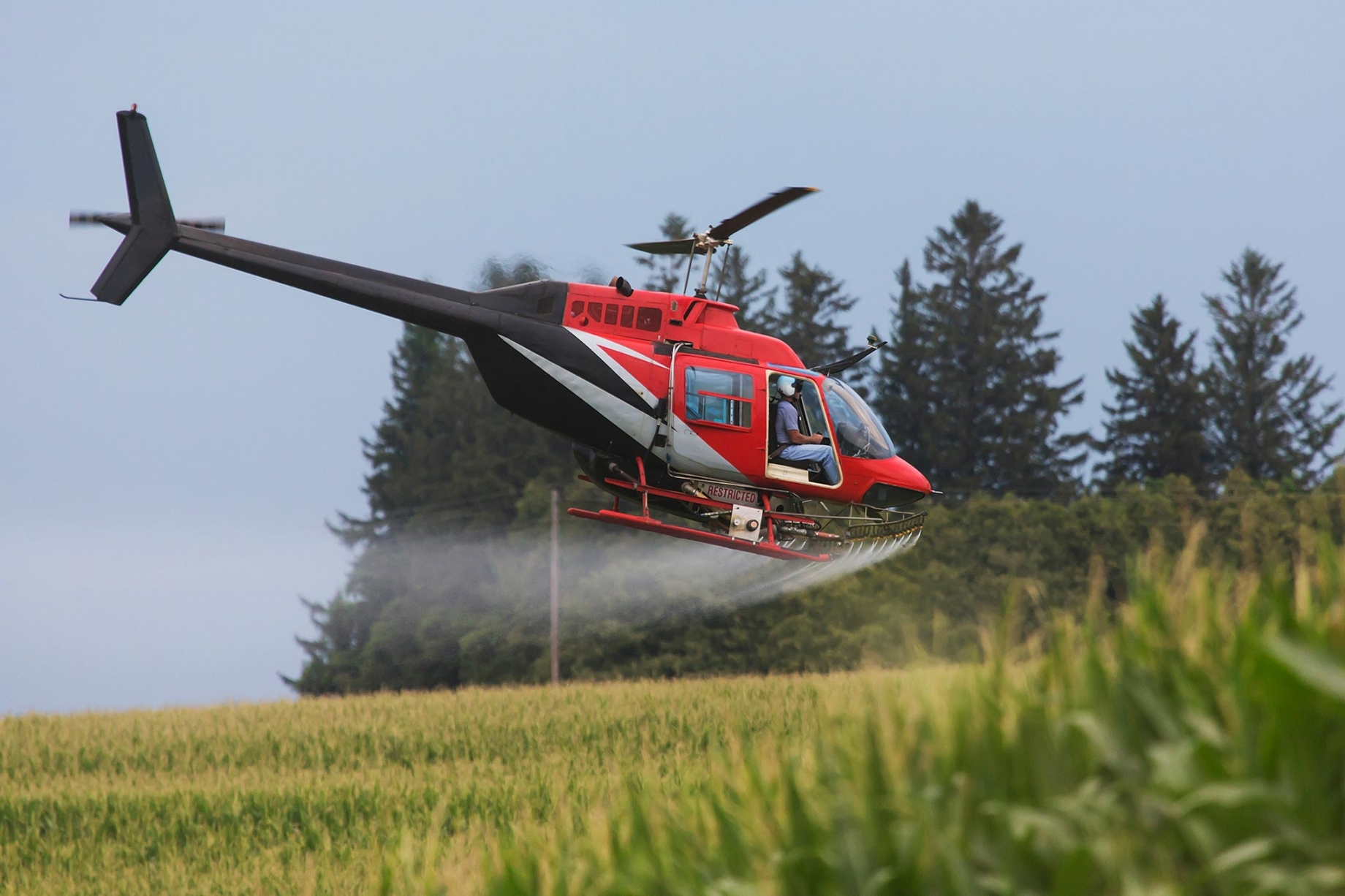 Helicopter crop dusting