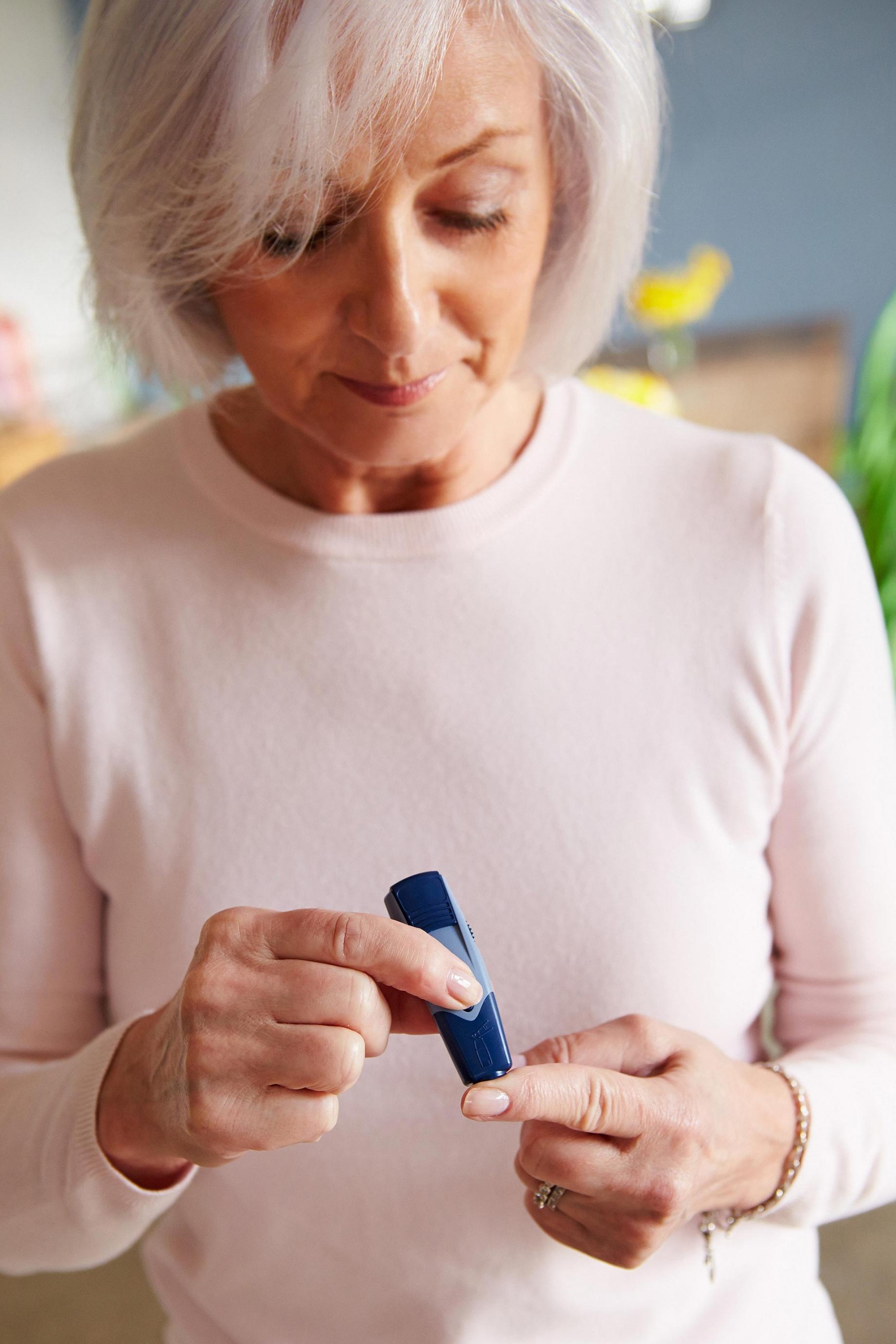 Woman checking blood sugar levels
