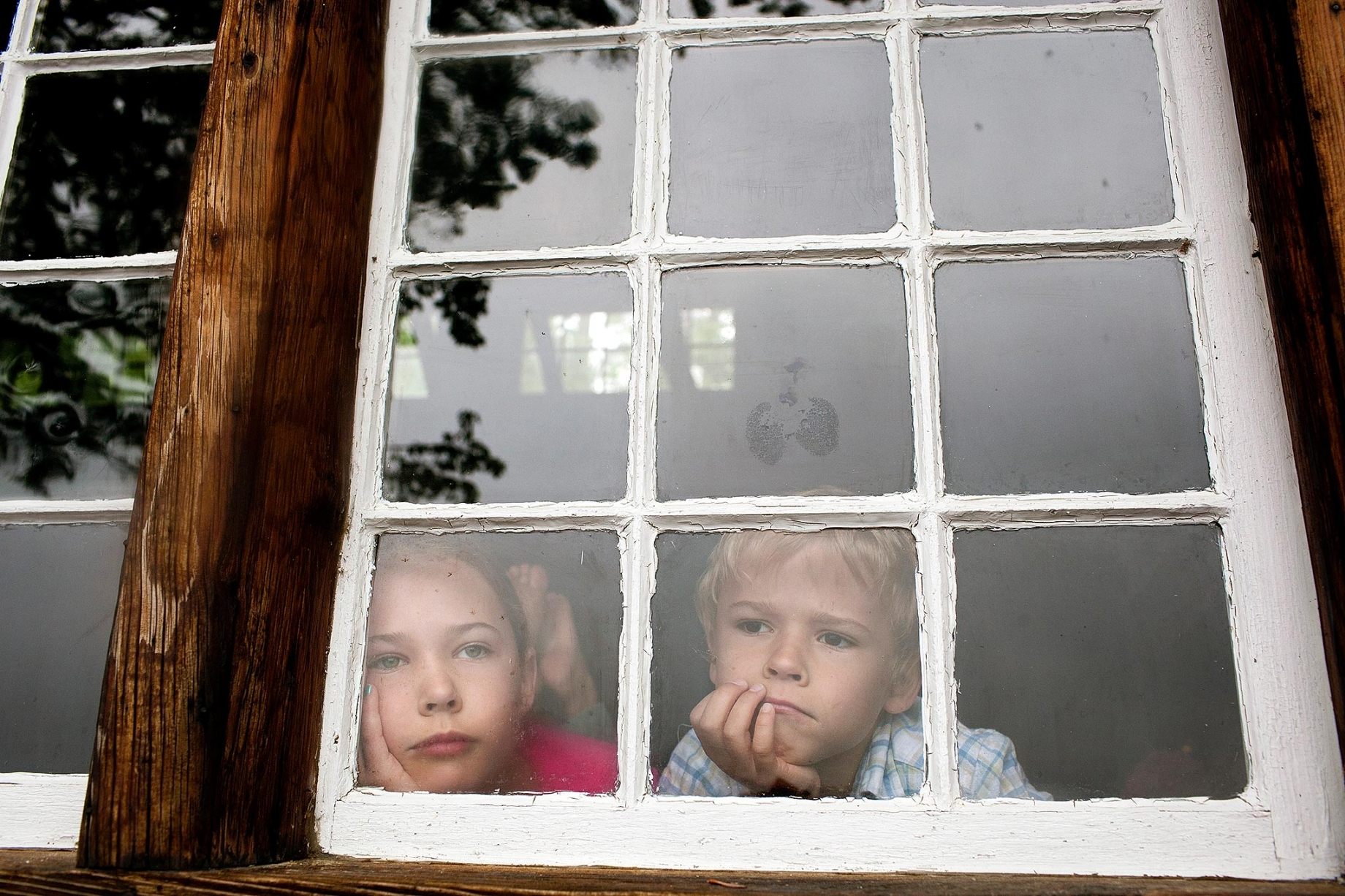 Children looking through window